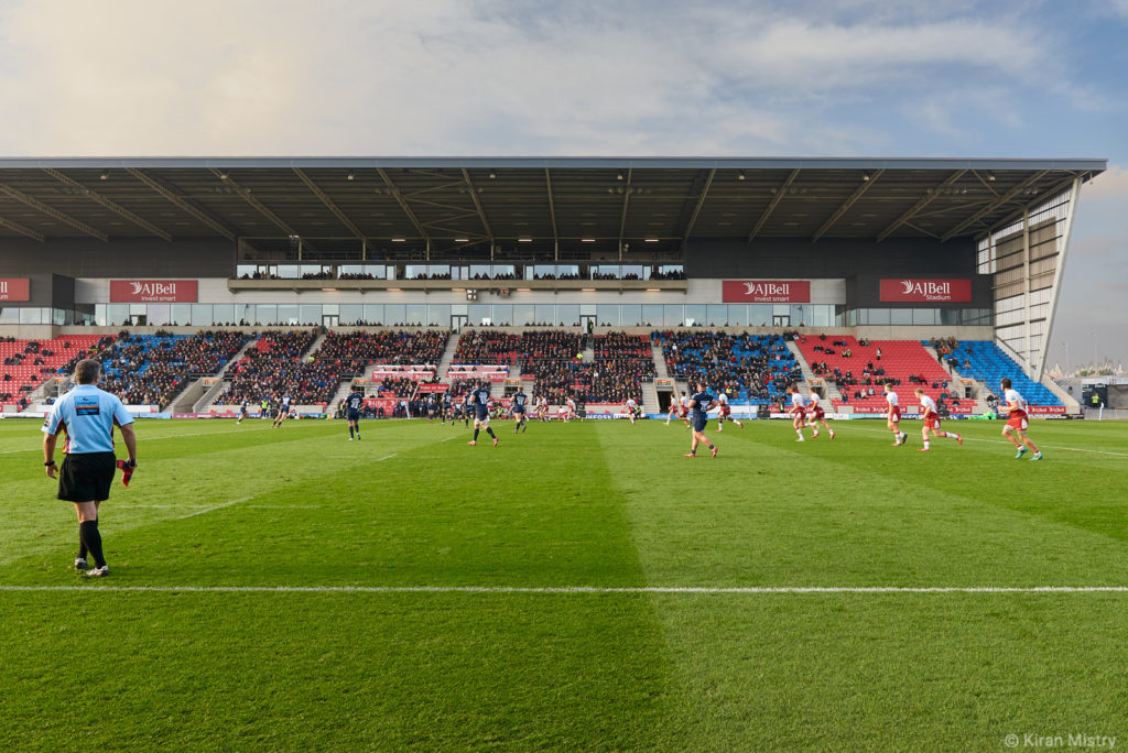 A rugby game in play at the AJ Bell stadium in Salford.