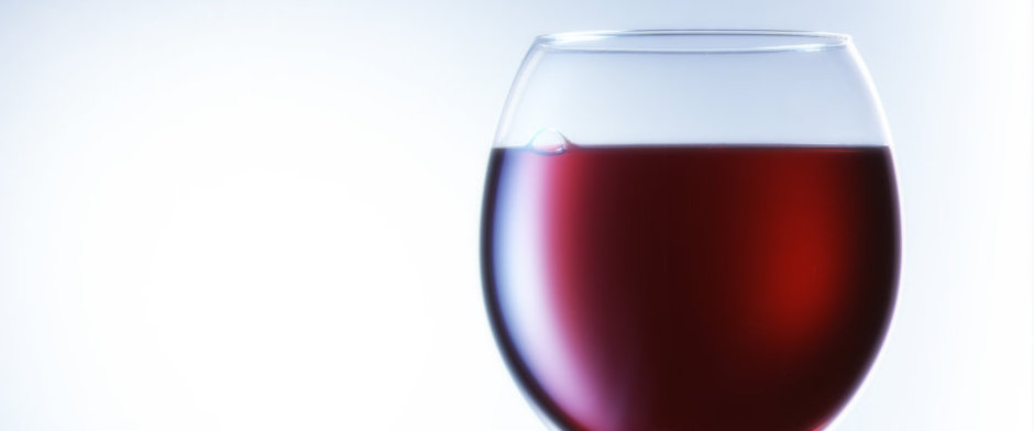 closeup red wine glass